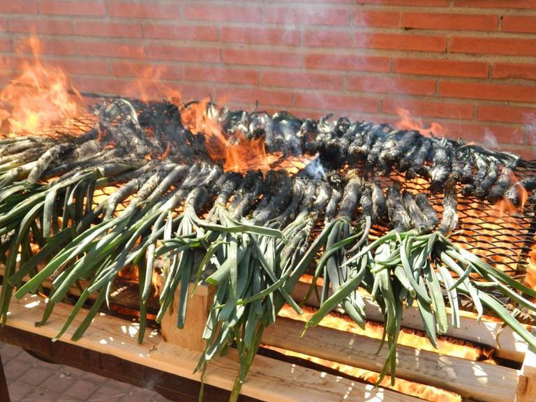 Calcots cooked over the grill