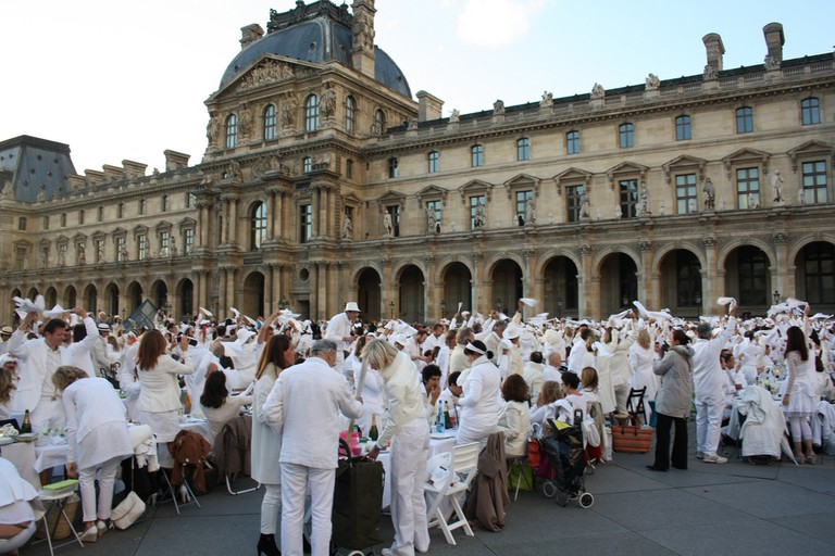 Everyone taking photos at the White Dinner at The Louvre in 2013 in Paris