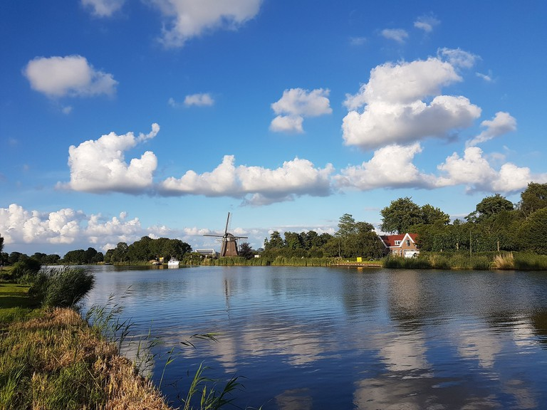 A windmill on the river Amstel