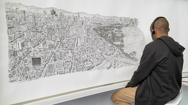Stephen Wiltshire working on the Mexico City skyline piece