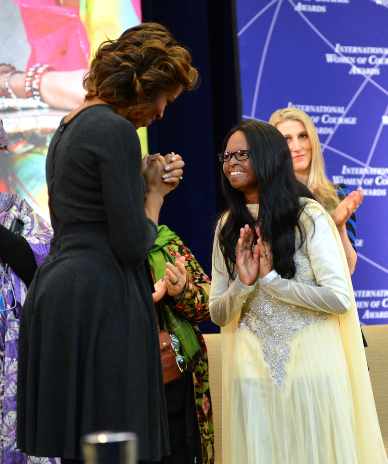 Michelle Obama giving the Secretary of State's International Women of Courage Award