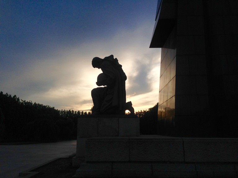 A statue at the soviet war memorial seen at dusk