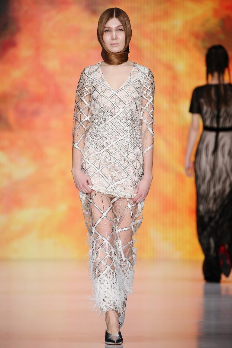 A model walks the runway at the Ksenia Knyazeva fashion show