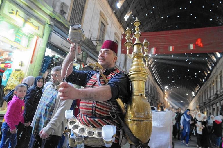 Isahak Kraymeen sells tamarind juice at the Hamidiya souk in Damascus, Syria. (Liliana Nieto del Rio / For The Times)