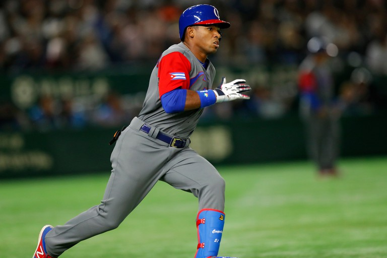 Yoelkis Cespedes of Team Cuba hits a double in third inning against Japan.