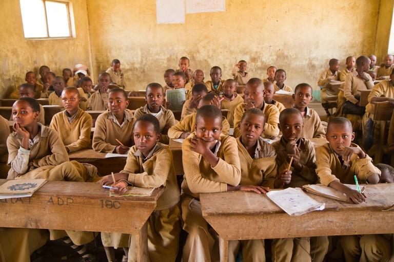 Students at Oldonyo masai school ©franco lucato / Shutterstock