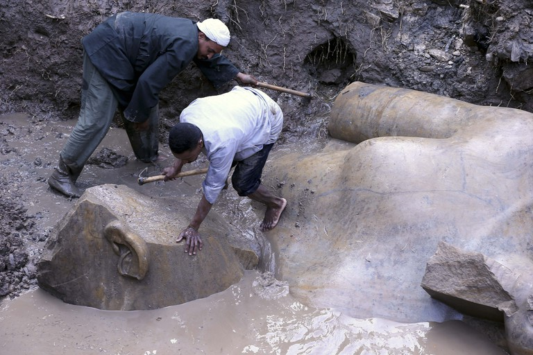 The colossal statue of Pharoah Ramses II being dug out of the groundwater