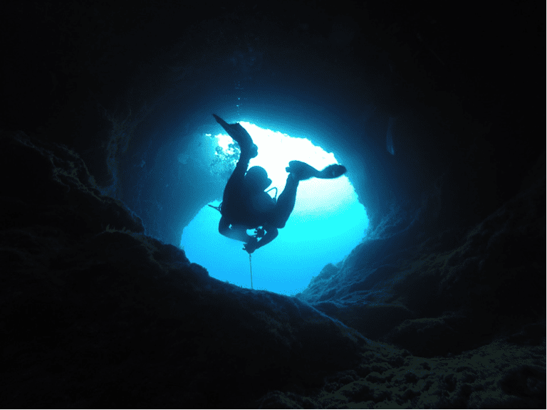 A diver exploring an underwater cave