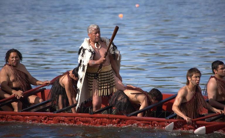 Maori men rowing a traditional waka (canoe)