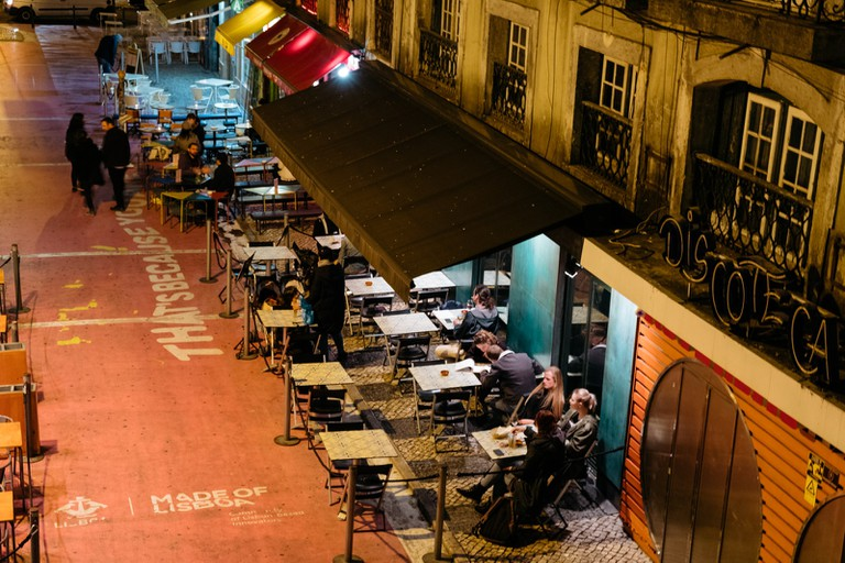 WATSON - LISBON, PORTUGAL - PINK STREET IN CAIS SODRÉ - VIEW OF O POVO FROM THE BRIDGE