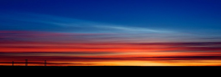 Polar Stratospheric Cloud type I above Cirrus at sunrise