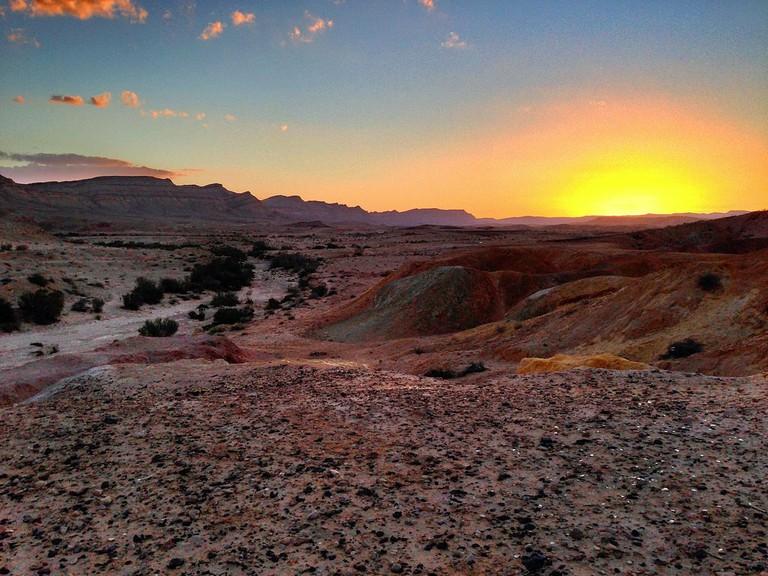 The sun sets over the Negev Desert