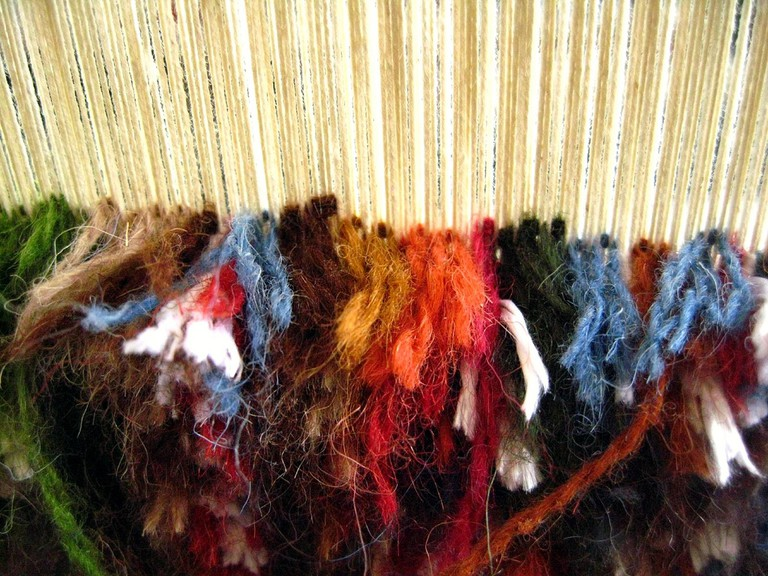 The process of rug weaving on a loom