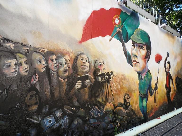 Lisbon street art depicting the Carnation Revolution