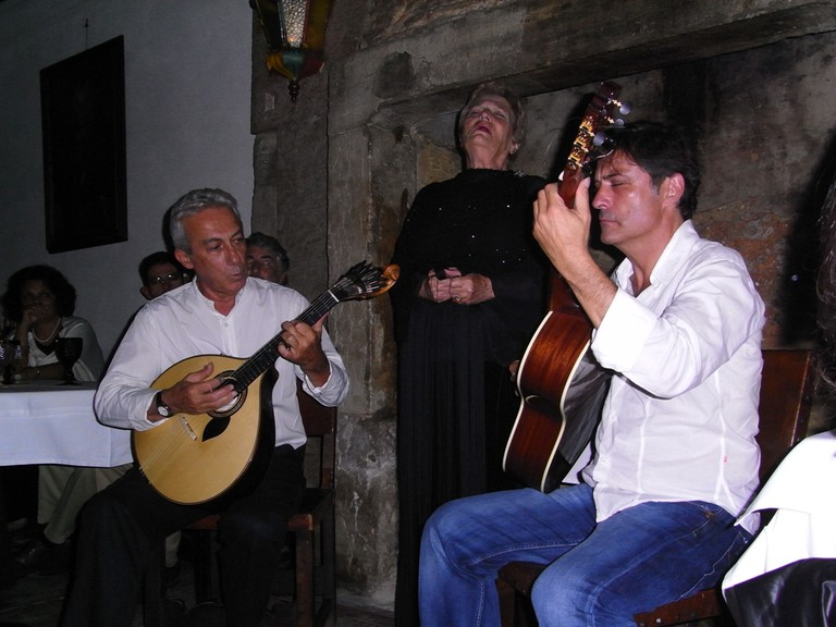 Fado singer in Alfama accompanied by guitarists