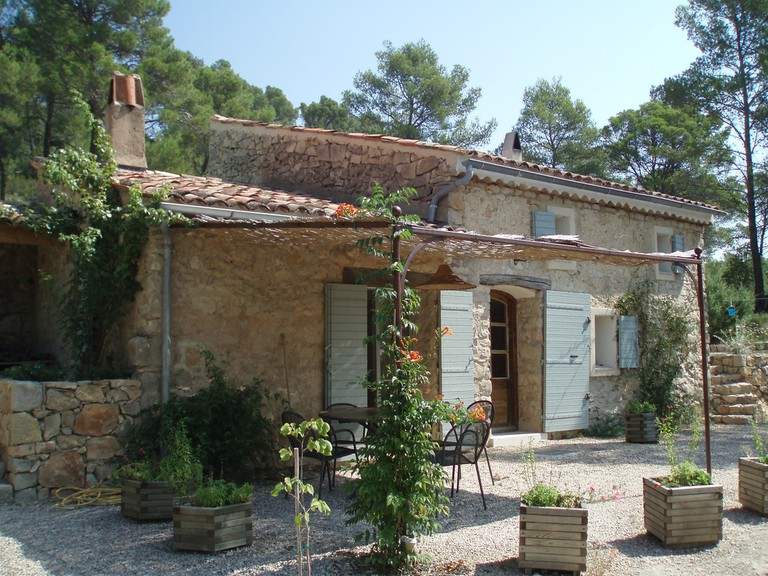 Provençal farmhouses are found throughout the region with traditional blue shutters