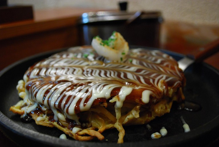'Okonomiyaki' served in a restaurant