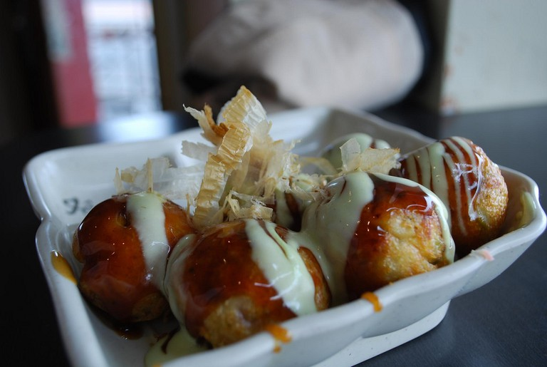 'Takoyaki' topped with mayonnaise and fish flakes