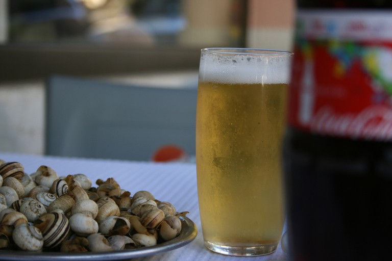A Portuguese summertime favorite: caracóis and beer