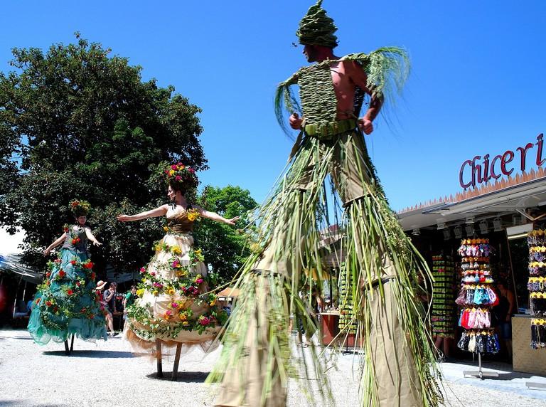 Stilt dancers at the summer Tollwood festival