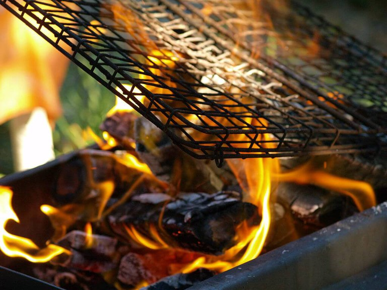 A grill is placed over the coals