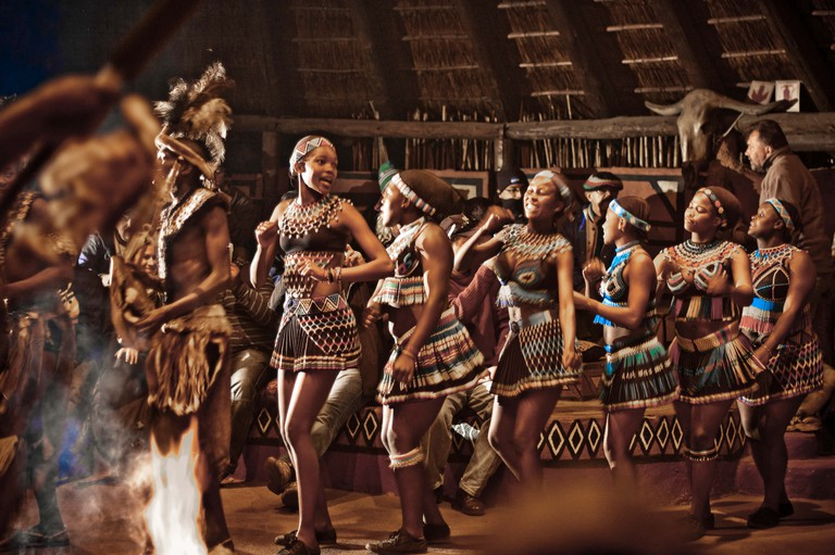 Discover fascinating local cultures and traditions at Lesedi Cultural Village