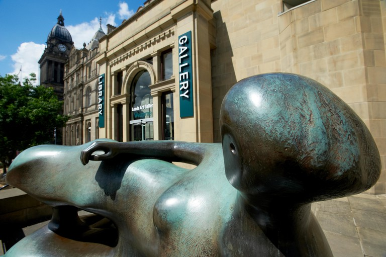 Leeds, UK. Reclining Woman sculpture by Henry Moore at the entrance to Leeds City Art Gallery, Library & Henry Moore Institute.