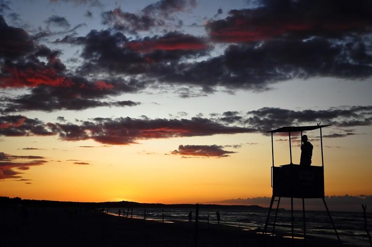 Baltic sea sunrise lifeguard silhouette