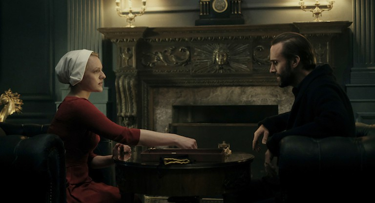 Elisabeth Moss, with Joseph Fiennes as the Commander
