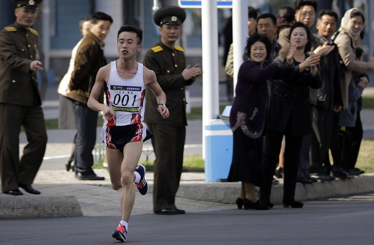 Pak Chol of North Korea (above) won his third consecutive Pyongyang Marathon