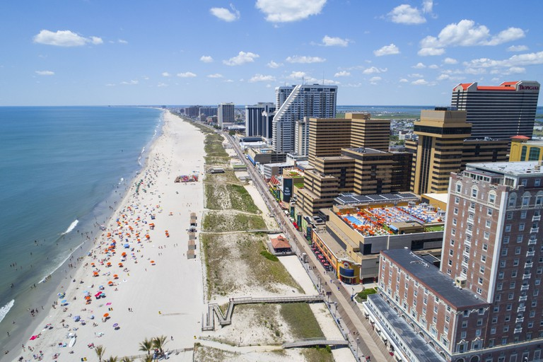 Aerial image of Atlantic City casinos and boardwalk on the beach.