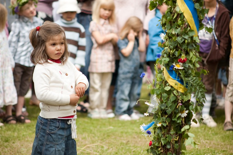 A child in Sweden celebrating the Solstice