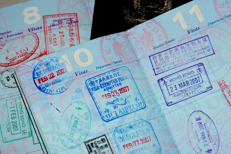 Passport stamps| © J Aaron Farr