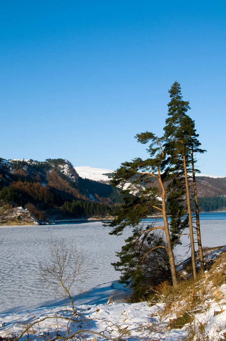 Thirlmere reservoir frozen over in winter, Lake District.