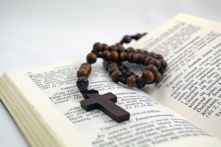 Rosary and a bible