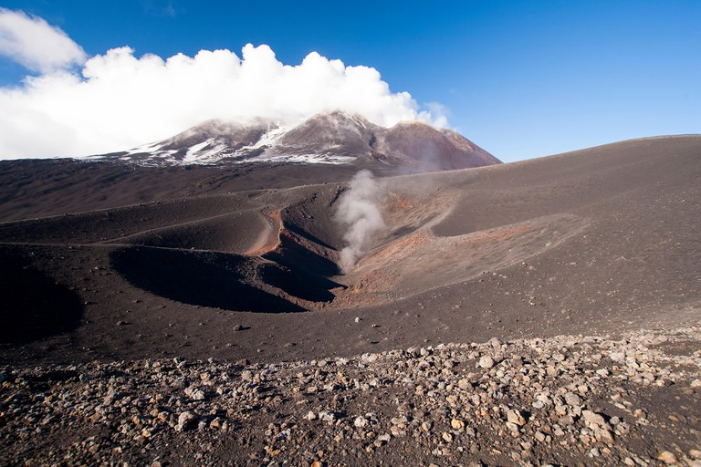Volcano smoking crater on side of Mount Etna Sicily, Italy.