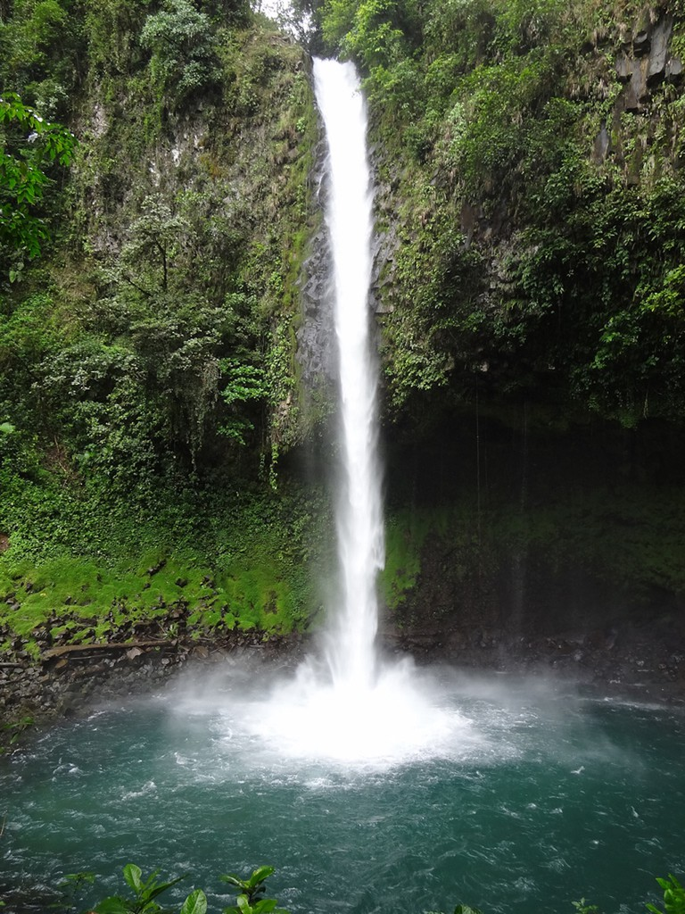 Take a dip beneath the La Fortuna falls
