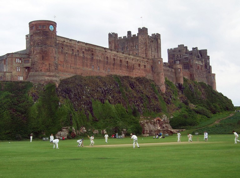 Bamburgh Cricket club on the green at Bamburgh Castle Northumberland