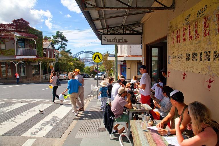 People sit outside a cafe in Balmain, Sydney