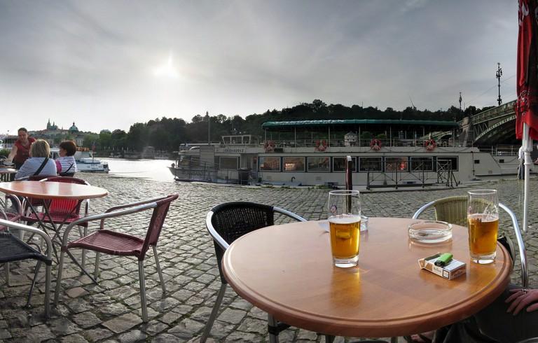 Pausing for a pilsner along the Vltava River, Prague