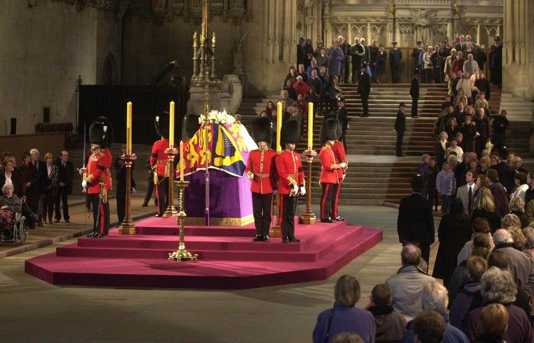 Guards stand by the coffin of Queen Mother laying in state at Westminster Hall