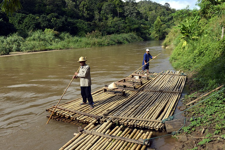 Raft drivers on a bamboo raft on the Mae Tang River, Chiang Mai Province, Northern Thailand