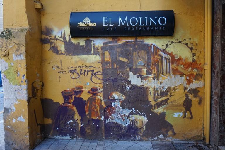 Street art by El Niño in Granada's Realejo; Encarni Novillo