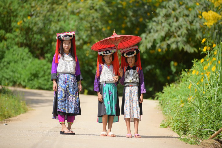 Three young Lahu tribe members in traditional dress