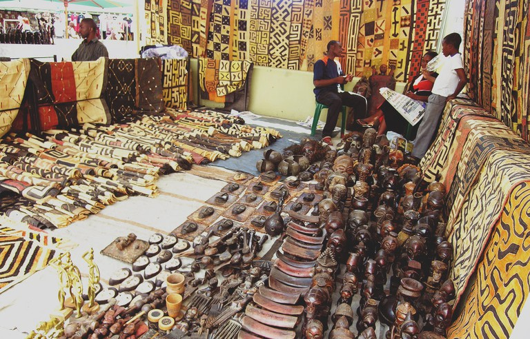There's a wide variety of African craft for sale at the market, including sculptures and fabrics