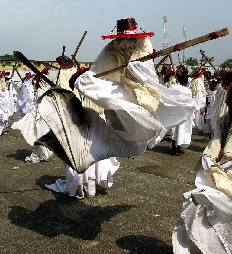 An Eyo doing a traditional jump