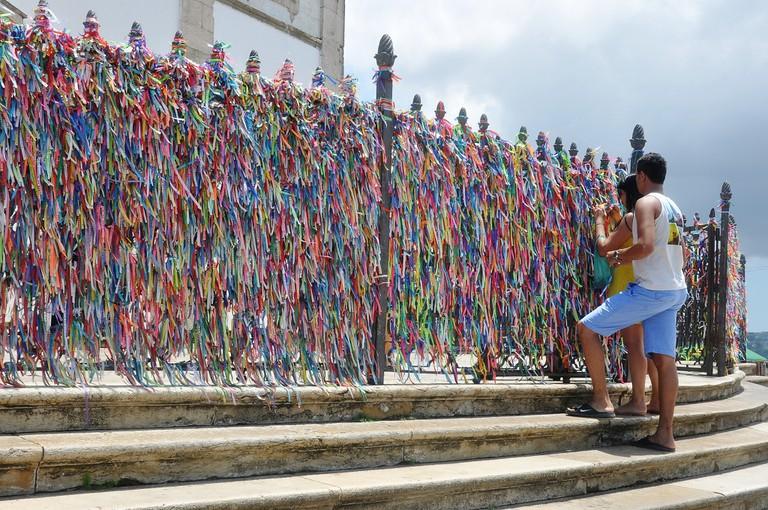 Ribbons tied to railings in Bahia I