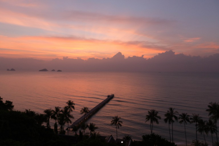 Sun setting behind clouds at Intercontinental Koh Samui Courtesy of Chris Hoare/Flickr