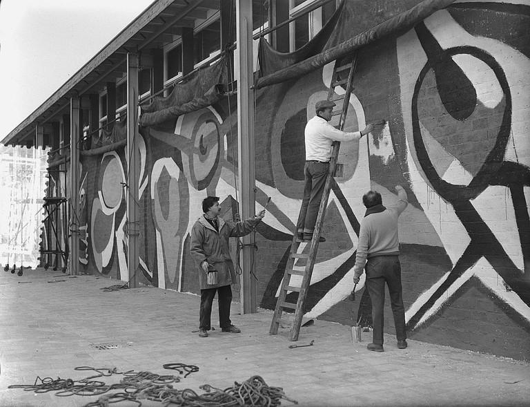 Karel Appel painting a mural in Rotterdam