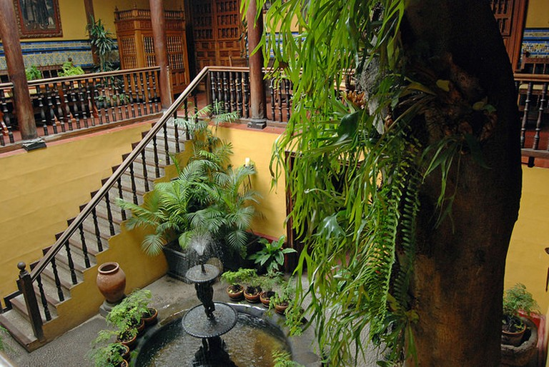 The colonial mansion's courtyard